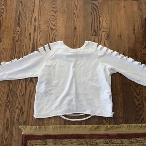 White sweatshirt with ripped sleeves and back